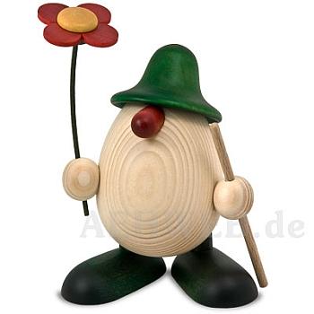 Eierkopf Rudi mit Blume und Stock grün