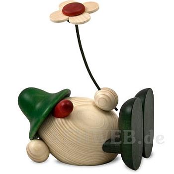 Eierkopf Oskar mit Blume liegend grün