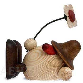 Eierkopf Oskar mit Blume liegend braun