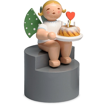 Angel with Cake sitting on Pedestal