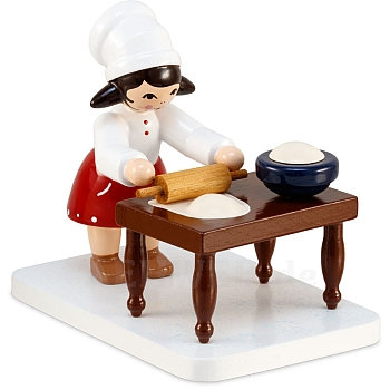 Plätzchenbäckerin rot mit Tisch von Ulmik