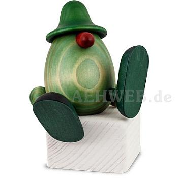 Grünes Männlein No. 5 auf Kante sitzend od. tanzend