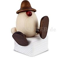 Eierkopf Alfons auf Kante sitzend oder tanzend braun