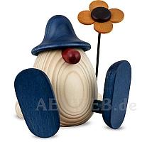 Eierkopf Erwin mit Blume sitzend blau