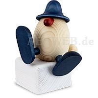Eierkopf Alfons auf Kante sitzend oder tanzend blau