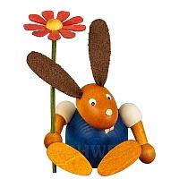 Hase mit Blume sitzend blau klein