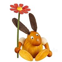Hase mit Blume sitzend gelb klein