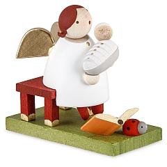 Schutzengel mit Baby sitzend