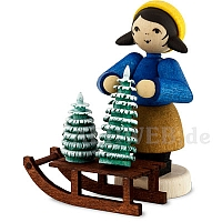 Weihnachtsbaumverkäuferin am Schlitten, gebeizt