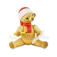 Weihnachtsbär mit Wunschzettel sitzend