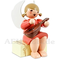 Angel sitting on gift package with Mandolin red