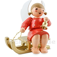 Angel sitting on sledge with Bell red