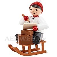 Junge auf Schlitten mit Paketen rot