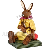 Easter bunny girl sitting with yellow dress and doll