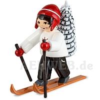 Baummauser Junge auf Ski rot
