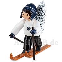 Baummauser Junge auf Ski blau