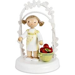 Geburtstagskind mit Äpfeln