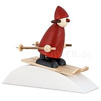 Weihnachtsfrau mit Ski mit Holzsockel