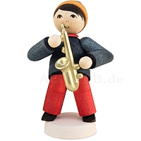Winter musician boy with saxophone stained