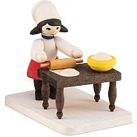 Plätzchenbäckerin mit Tisch gebeizt