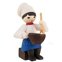 Plätzchenbäckerin mit Schüssel gebeizt