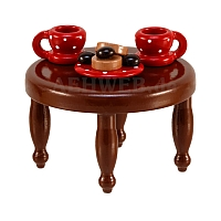 Coffee table with red dishes from Ulmik