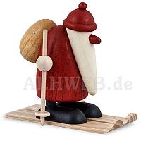 Weihnachtsmann auf Ski stehend