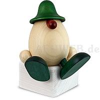 Eierkopf Anton auf Kante sitzend grün